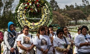 Mothers with missing daughters accompany Maria Eugenia Fuentes at the funeral of her daughter Diana. (Ginnette Riquelme)
